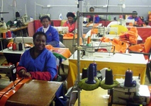 Sewing 2000 toolbags for Angola, with Mechem